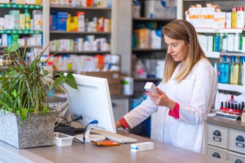 pharmacist at computer