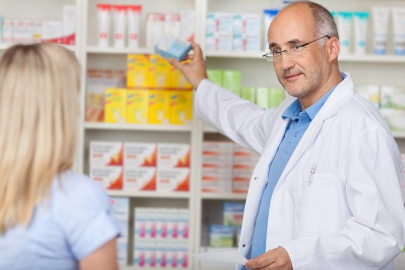 pharmacist helping woman